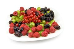 Different berries in a plate on a white background Royalty Free Stock Photography