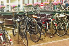 Different bicycles in the historical center of Amsterdam. royalty free stock photography