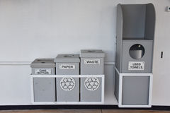 Different bins for bottles paper and waste Royalty Free Stock Photography