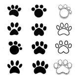 Different black paw prints animals set. Stock Image