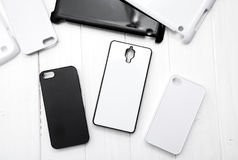 Different black and white cellphone cases, topshot Stock Photos