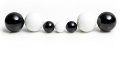 Different black and white marbles Stock Photos