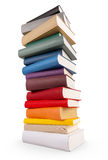 Different books. A book tower with different colored books stock images