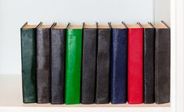 Different books on shelf Stock Images