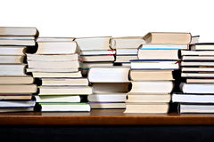 Different books on wooden desk Royalty Free Stock Photography