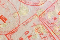 Different border stamps in a passport page - travel. Background Royalty Free Stock Photo
