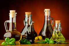 Different bottles of infused olive oil Royalty Free Stock Photography