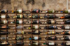 Different bottles of wines stacked on a ancient cellar royalty free stock image