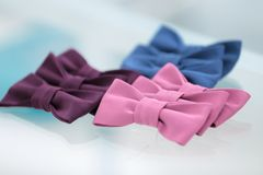 Different bow ties on glass background. Different bow ties on glass table background Stock Photos