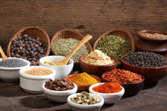 Different bowls of spices stock photography
