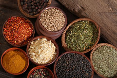 Different bowls of spices over a wooden background Stock Image