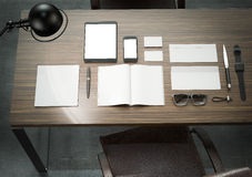Different branding mockup elements. Template set on wood table Royalty Free Stock Photos