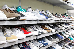Different brands of sport shoes. Different brands and types of sport shoes in a shoe store Stock Photos
