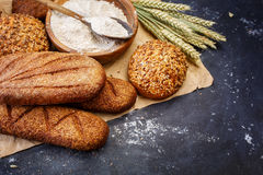 Different bread on a  dark background Royalty Free Stock Images