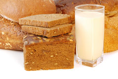 Different bread with milk. Different bread arranged on table close up Royalty Free Stock Photography