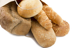 Different bread in a paper bag Stock Photos