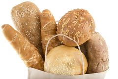 Different bread in a paper bag on a white Stock Image