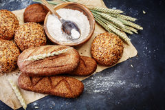 Different bread on a rustic dark background Royalty Free Stock Photography