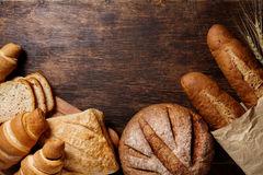 Different bread on a rustic dark background Stock Photography