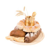 Different breads. Jar and tray of wood. Ears. Stock Photo