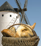 Different breads and windmill in the background Stock Images