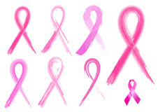 7 different breast cancer ribbons in brush strokes Royalty Free Stock Photos