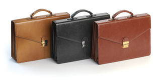 Different briefcases on a white background. Briefcase shop or ma Royalty Free Stock Image