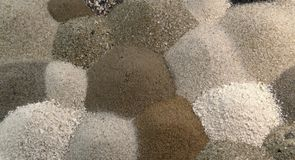 Different brown toned sand piles to one another Stock Photo