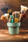 Different brushes in the bucket Stock Photo