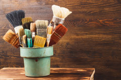 Different brushes in the bucket Royalty Free Stock Images