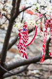 Different Bulgarian Martenitsa signs on the blossoming tree Royalty Free Stock Photos
