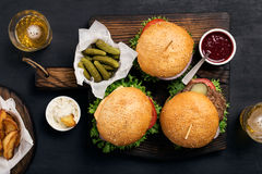 Different burger with pickles, ketchup, mayonnaise, fries and li Royalty Free Stock Photo
