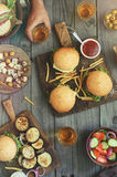 Different burgers and beer royalty free stock photography
