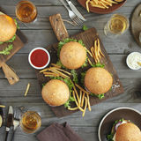 Different burgers and wine Royalty Free Stock Photography