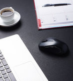 Different business objects on a black table Royalty Free Stock Photo
