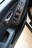 Different buttons from the car door Stock Photos
