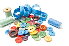 Different buttons and spools of thread Royalty Free Stock Images
