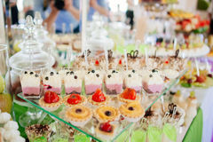 Different cakes on banquet table Stock Photos