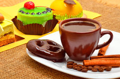 Different cakes, cup of coffee, cinnamon sticks and chocolate co Royalty Free Stock Image