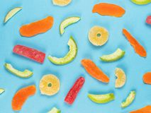 Different candied fruits on blue flat lay stock photos