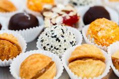 Different candies, cookies and biscuits on banquet table. Stock Photos