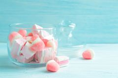 Different candies in glass jar. On wooden background Royalty Free Stock Images