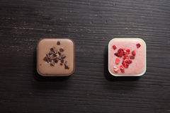 Different candies on a wooden table. Two different candies on a wooden table viewed from above Royalty Free Stock Photography