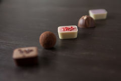 Different candies on a wooden table. Different candies on a wooden table viewed from above Stock Images