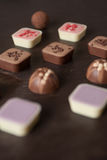 Different candies on a wooden table. Different candies on a wooden table viewed from above Royalty Free Stock Image