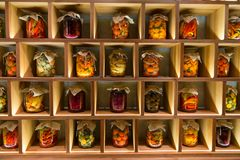 Different canned vegetable preserves in jars on the wooden shelf. royalty free stock image