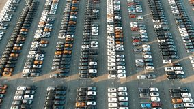 Different car rows parked on finished auto warehouse area. Rows of different cars parked on huge finished auto warehouse parking area with white marking and stock video