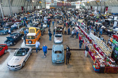 Different cars and bikes in the exhibition hall. Royalty Free Stock Images