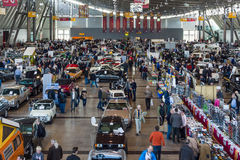 Different cars and bikes in the exhibition hall. Stock Photography
