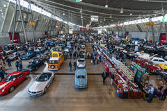 Different cars and bikes in the exhibition hall. Stock Image
